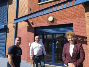 Communities Minister Carál Ní Chuilín pictured at the Blackie Centre with Sean Quinn, chairman of Blackie River Community Group and Community Development Coordinator Ciaran Beattie for the reopening of the COVID-19 Charities Fund.