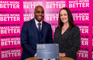 NICVA HR Manager Alex Hastings receiving Investors in People Gold accreditation award