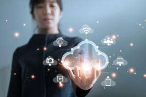 Woman holding virtual cloud